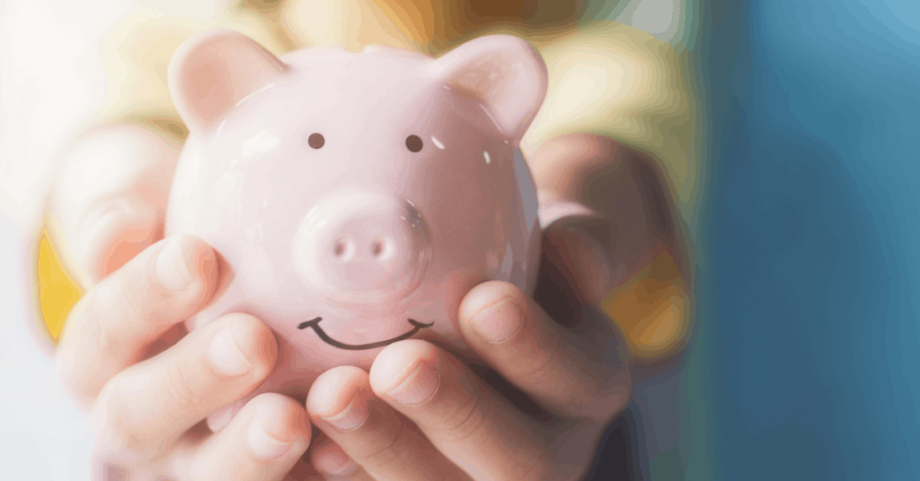 hand holding piggy bank