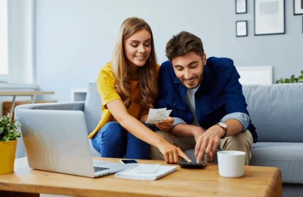 man and woman using calculator