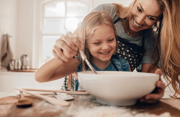 woman cooking with child