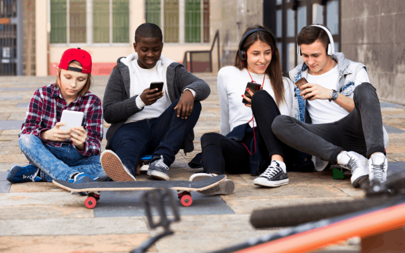 teens texting in a group